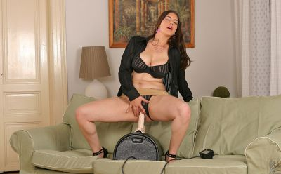 Photo №2 Horny brunette Liana fucks guy with big tits while sitting on a rubber cock