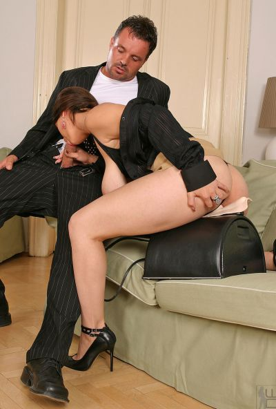 Photo №4 Horny brunette Liana fucks guy with big tits while sitting on a rubber cock