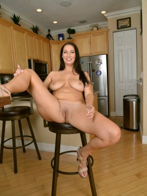 Lustful wife Tiffany Cane strips and spreads her pussy in the kitchen