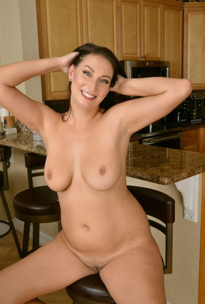 Photo №13 Lustful wife Tiffany Cane strips and spreads her pussy in the kitchen