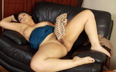 Photo №12 Chubby MILF Kiki licks her toes before spreading hairy holes