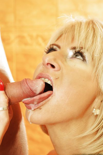 Photo №13 Mature blonde Magda sucks cock of young guy