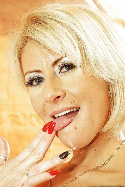 Photo №15 Mature blonde Magda sucks cock of young guy