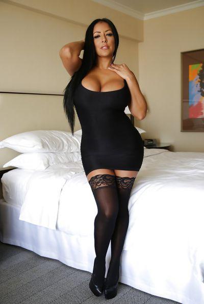 Photo №2 Busty brunette MILF Kiara Mia in stockings
