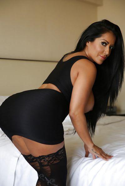 Photo №7 Busty brunette MILF Kiara Mia in stockings