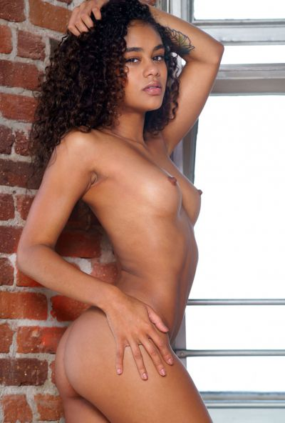 Photo №12 Young curly-haired mulatto Scarlit Scandal undressed and posing for the camera