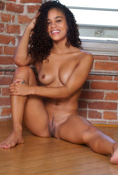 Photo №14 Young curly-haired mulatto Scarlit Scandal undressed and posing for the camera