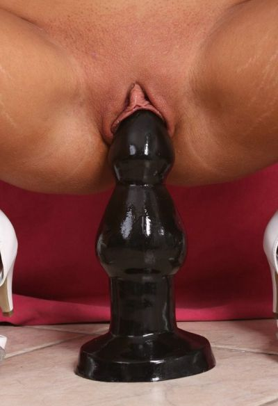 Photo №7 Dark-skinned brunette Tiffany sits on a huge black dildo