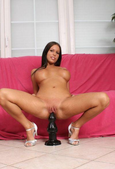 Photo №8 Dark-skinned brunette Tiffany sits on a huge black dildo