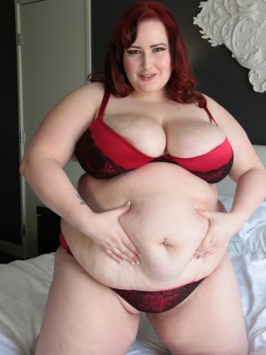 Redhead fatty Eliza Allure uncovers her great big tits & spreads BBW pussy