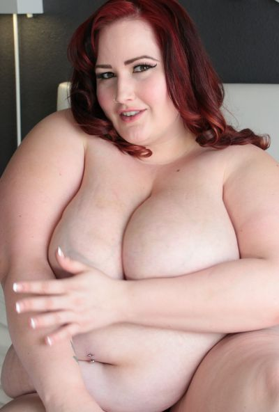 Photo №12 Redhead fatty Eliza Allure uncovers her great big tits & spreads BBW pussy