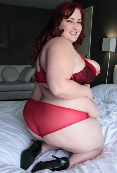 Photo №5 Redhead fatty Eliza Allure uncovers her great big tits & spreads BBW pussy