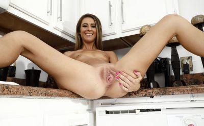 Photo №10 Housewife Tara Ashley spreads holes close-up and pisses in a bowl in the kitchen