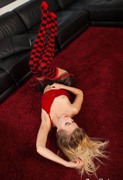 Photo №4 Teen blonde girl Zoey Ryder in black-red socks shows off her sexy ass