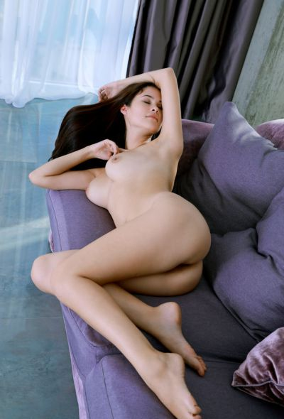 Photo №12 Blue-eyed brunette Martina Mink stripped naked and posing beautifully on the couch