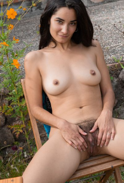 Photo №10 Seductive brunette Tiffany strips off her shirt and panties and spreads her hairy vulva