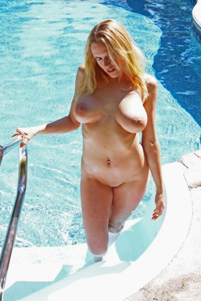 Photo №20 Naked busty blonde Alecia posing in the pool