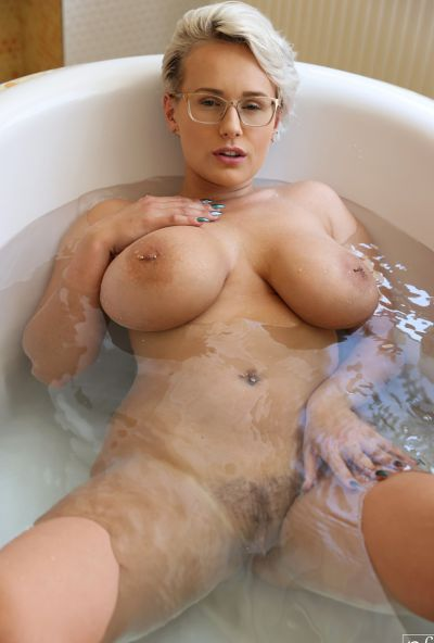 Photo №1 MILF with glasses Angel Wicky jerks off a cock with huge tits and gets cum on them