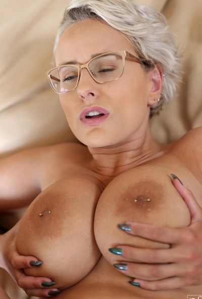 Photo №19 MILF with glasses Angel Wicky jerks off a cock with huge tits and gets cum on them
