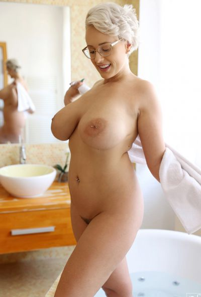 Photo №4 MILF with glasses Angel Wicky jerks off a cock with huge tits and gets cum on them