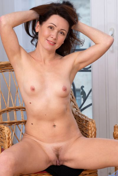 Photo №11 Mature housewife Ptica fingers her pussy after getting undressed