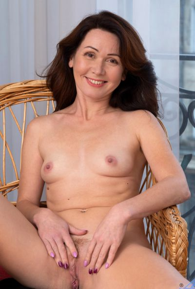 Photo №12 Mature housewife Ptica fingers her pussy after getting undressed