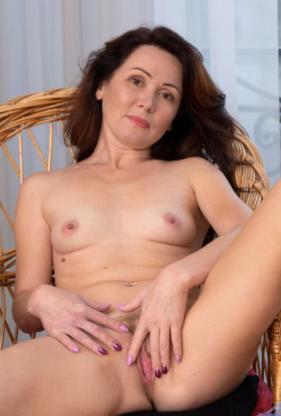 Photo №13 Mature housewife Ptica fingers her pussy after getting undressed