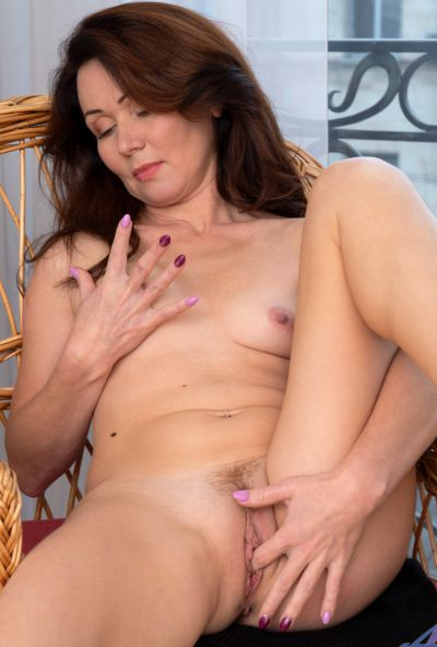 Photo №14 Mature housewife Ptica fingers her pussy after getting undressed