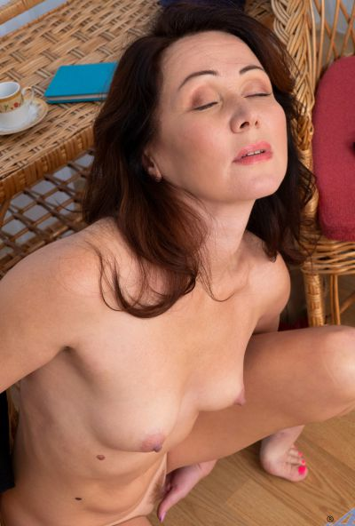 Photo №19 Mature housewife Ptica fingers her pussy after getting undressed