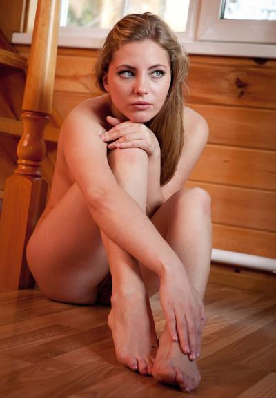 Photo №19 Attractive blonde Tami A posing naked on wooden stairs