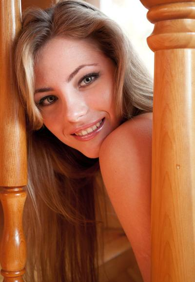 Photo №9 Attractive blonde Tami A posing naked on wooden stairs