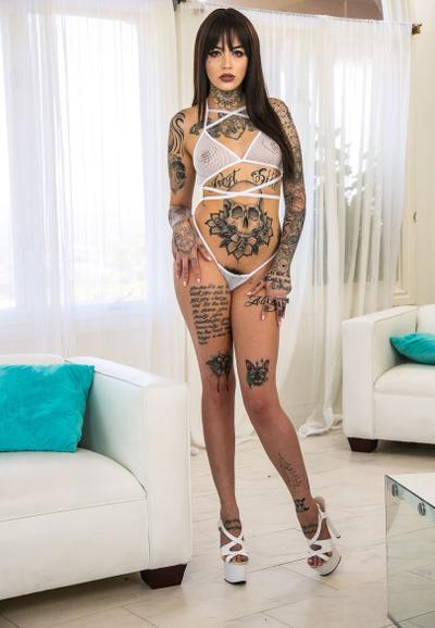 Photo №1 Tattooed beauty Leigh Raven frees small tits and hairy pussy from lingerie