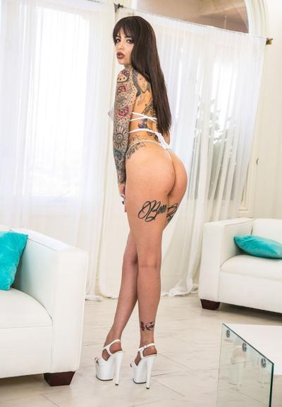 Photo №10 Tattooed beauty Leigh Raven frees small tits and hairy pussy from lingerie