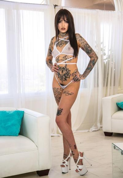 Photo №2 Tattooed beauty Leigh Raven frees small tits and hairy pussy from lingerie