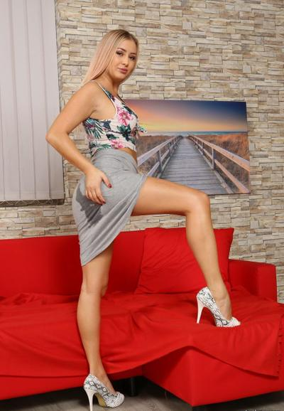 Photo №6 Sexy blonde Cayla toys her wet pussy and pees in a glass bowl