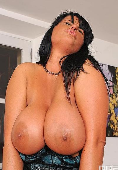 Photo №10 Two lesbians with huge tits lick each other's slits and nipples