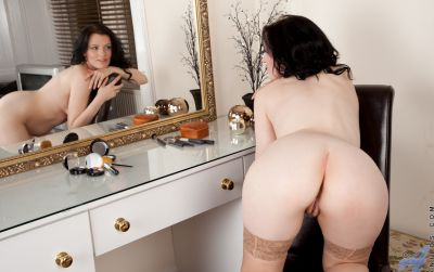 Photo №11 Middle-aged wife in stockings Charisma Jones reveals her saggy tits and shaved pussy