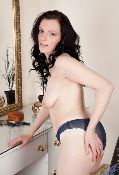 Photo №7 Middle-aged wife in stockings Charisma Jones reveals her saggy tits and shaved pussy