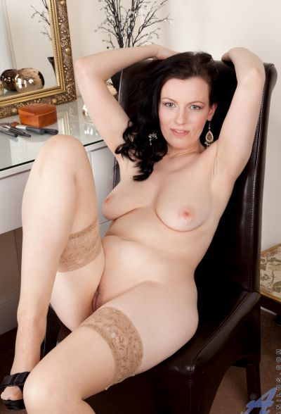 Photo №9 Middle-aged wife in stockings Charisma Jones reveals her saggy tits and shaved pussy