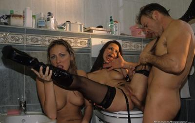 Photo №10 Threesome BDSM sex with two sluts in the toilet
