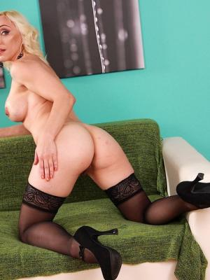 Mature blonde in stockings Irene Telesta took off her clothes and put two fingers in her pussy
