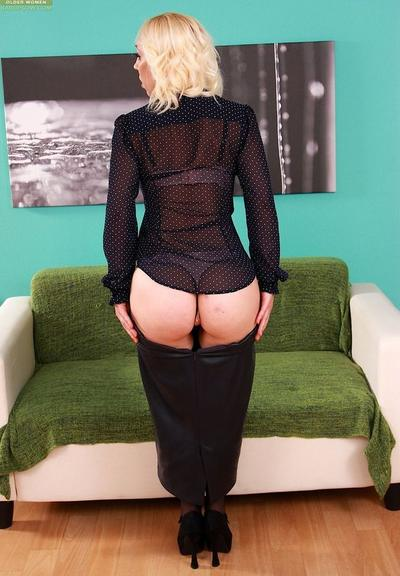 Photo №3 Mature blonde in stockings Irene Telesta took off her clothes and put two fingers in her pussy