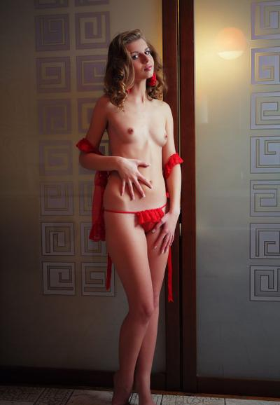 Photo №3 Young charming girl got rid of red underwear and spreads her legs on a chair