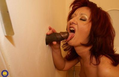 Photo №13 Redhead mature mom Monika fucks big black dick at gloryhole in the toilet