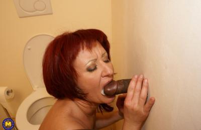 Photo №15 Redhead mature mom Monika fucks big black dick at gloryhole in the toilet