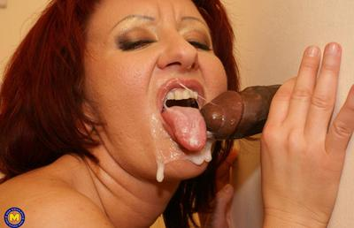 Photo №17 Redhead mature mom Monika fucks big black dick at gloryhole in the toilet