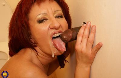 Photo №18 Redhead mature mom Monika fucks big black dick at gloryhole in the toilet