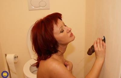 Photo №20 Redhead mature mom Monika fucks big black dick at gloryhole in the toilet