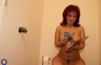 Photo №3 Redhead mature mom Monika fucks big black dick at gloryhole in the toilet