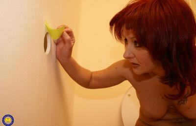 Photo №4 Redhead mature mom Monika fucks big black dick at gloryhole in the toilet